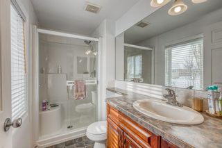 Photo 16: 211 Somme Manor SW in Calgary: Garrison Woods Semi Detached for sale : MLS®# A1071337