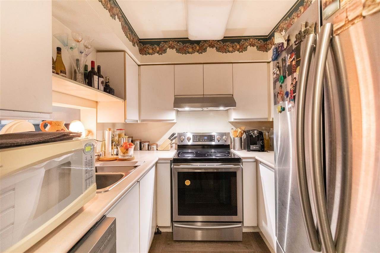 "Main Photo: 102 2588 E BROADWAY in Vancouver: Renfrew Heights Condo for sale in ""Gardenia Villa"" (Vancouver East)  : MLS®# R2523312"