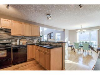 Photo 12: 69 STRATHLEA Place SW in Calgary: Strathcona Park House for sale : MLS®# C4101174