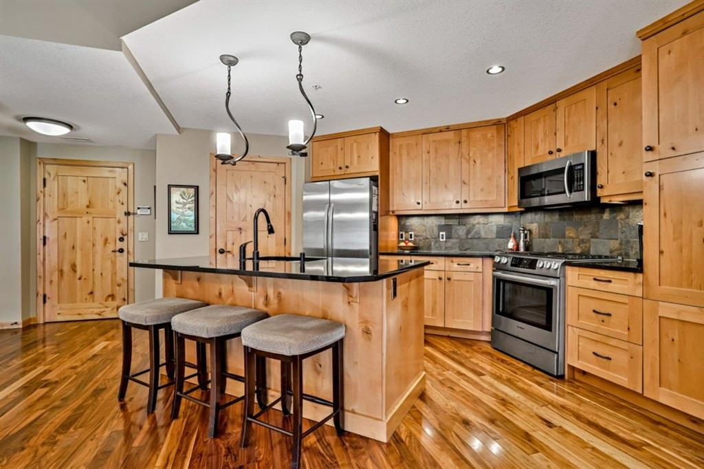 Main Photo: 203 600 spring creek Street Drive: Canmore Apartment for sale : MLS®# A1149900