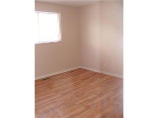 Photo 7: 30 ERIN RIDGE Place SE in CALGARY: Erinwoods Residential Detached Single Family for sale (Calgary)  : MLS®# C3602698