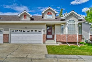 Photo 1: 59 Scotia Landing NW in Calgary: Scenic Acres Semi Detached for sale : MLS®# A1119656