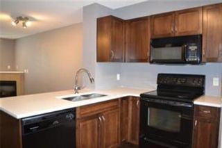 Photo 5: 92 Panamount Drive NW in Calgary: Panorama Hills Row/Townhouse for sale : MLS®# A1122234