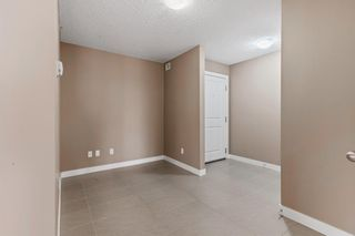 Photo 20: 7411 403 Mackenzie Way SW: Airdrie Apartment for sale : MLS®# A1152134