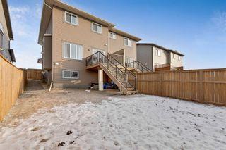 Photo 39: 333 Heartland Crescent: Cochrane Semi Detached for sale : MLS®# A1063240