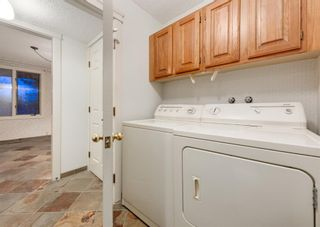 Photo 24: 24 WOOD Crescent SW in Calgary: Woodlands Row/Townhouse for sale : MLS®# A1154480