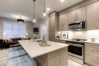 Photo 2: 417 383 Smith Street NW in Calgary: University District Apartment for sale : MLS®# A1145534