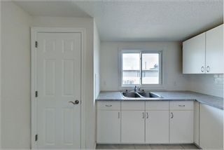 Photo 2: 7717 & 7719 41 Avenue NW in Calgary: Bowness 4 plex for sale : MLS®# A1084041