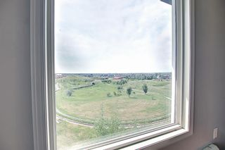 Photo 14: 6413 304 Mackenzie Way SW: Airdrie Apartment for sale : MLS®# A1128019