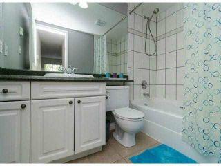 "Photo 12: 306 13955 LAUREL Drive in Surrey: Whalley Condo for sale in ""King George Manor"" (North Surrey)  : MLS®# F1422103"