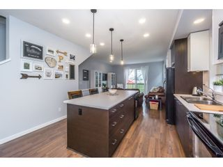 """Photo 11: 29 7348 192A Street in Surrey: Clayton Townhouse for sale in """"KNOLL"""" (Cloverdale)  : MLS®# R2100278"""