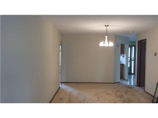 """Photo 3: 230 15153 98 Avenue in Surrey: Guildford Townhouse for sale in """"Glenwood Village"""" (North Surrey)  : MLS®# F1404287"""