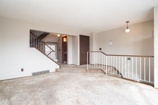 Photo 3: 5 903 67 Avenue SW in Calgary: Kingsland Row/Townhouse for sale : MLS®# A1079413