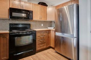 Photo 5: 805 800 Yankee Valley Boulevard SE: Airdrie Row/Townhouse for sale : MLS®# A1103338