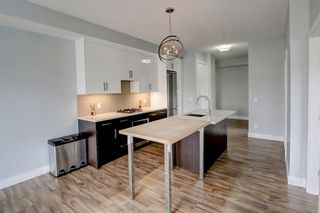 Photo 8: 405 1521 26 Avenue SW in Calgary: South Calgary Apartment for sale : MLS®# A1106456