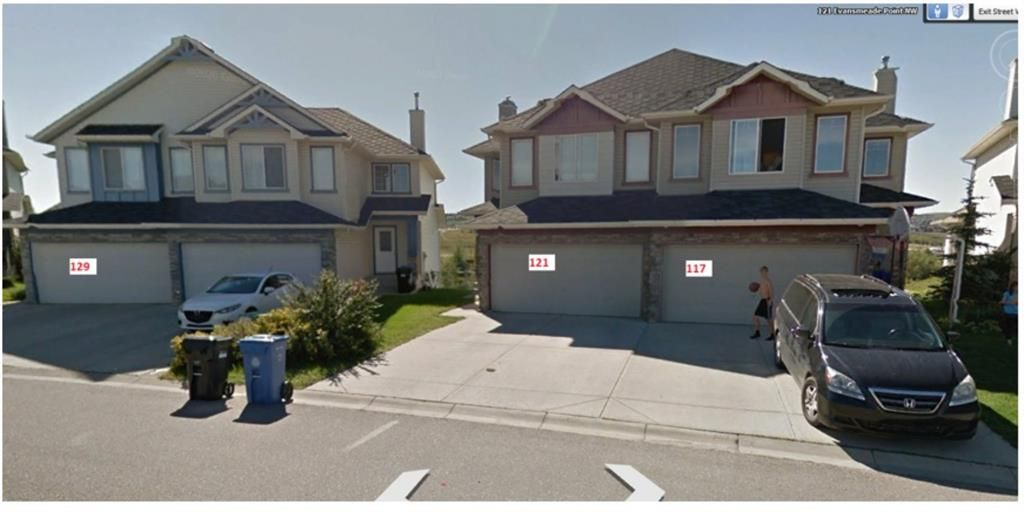 Main Photo: 117, 121 & 129 Evansmeade Point NW in Calgary: Evanston Duplex for sale : MLS®# A1066720