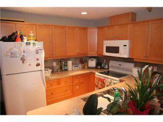 Photo 4: 107 2121 98 Avenue SW in CALGARY: Palliser Condo for sale (Calgary)  : MLS®# C3574647