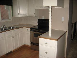Photo 9: 220 50 Avenue: Claresholm Semi Detached for sale : MLS®# C4048339