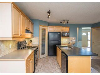 Photo 12: 150 BRIDLECREEK Park SW in Calgary: Bridlewood House for sale : MLS®# C4086800