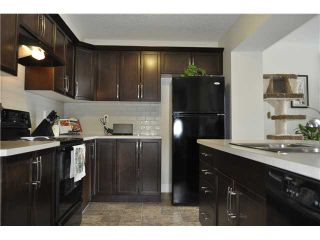 Photo 3: 118 WINDSTONE Crescent SW: Airdrie Townhouse for sale : MLS®# C3590682