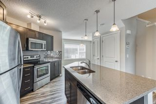 Photo 4: 68 Sunvalley Road: Cochrane Row/Townhouse for sale : MLS®# A1126120
