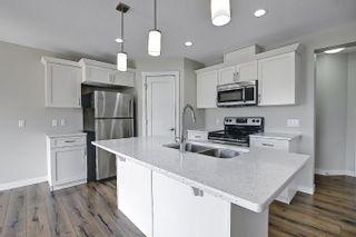 Photo 10: 16611 14 Avenue in Edmonton: Zone 56 House Half Duplex for sale : MLS®# E4248424