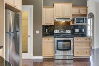Photo 24: 204 SUNTERRA Boulevard: Cochrane House for sale : MLS®# C4164735