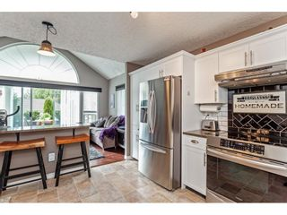 """Photo 14: 147 4001 OLD CLAYBURN Road in Abbotsford: Abbotsford East Townhouse for sale in """"CEDAR SPRINGS"""" : MLS®# R2555932"""