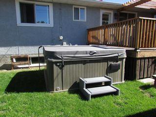 Photo 3: 209 9 Avenue NE: Sundre Detached for sale : MLS®# A1120415