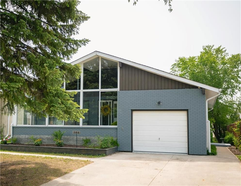 386 Glenway Avenue..... The perfect place to call Home! Wide front drive, attached garage and a very welcoming sunroom!
