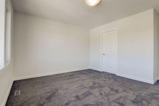 Photo 34: 136 Creekside Drive SW in Calgary: C-168 Semi Detached for sale : MLS®# A1108851