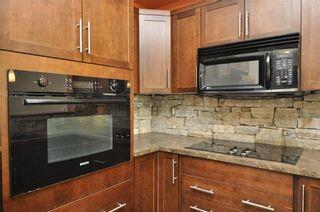 Photo 3: 337 26 VAL GARDENA View SW in Calgary: Springbank Hill Condo for sale : MLS®# C4139535