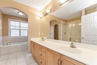 Photo 16: 7 39 Strathlea Common SW in Calgary: Strathcona Park Semi Detached for sale : MLS®# A1056254