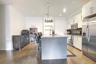 Photo 7: 304 414 MEREDITH Road NE in Calgary: Crescent Heights Apartment for sale : MLS®# A1119417