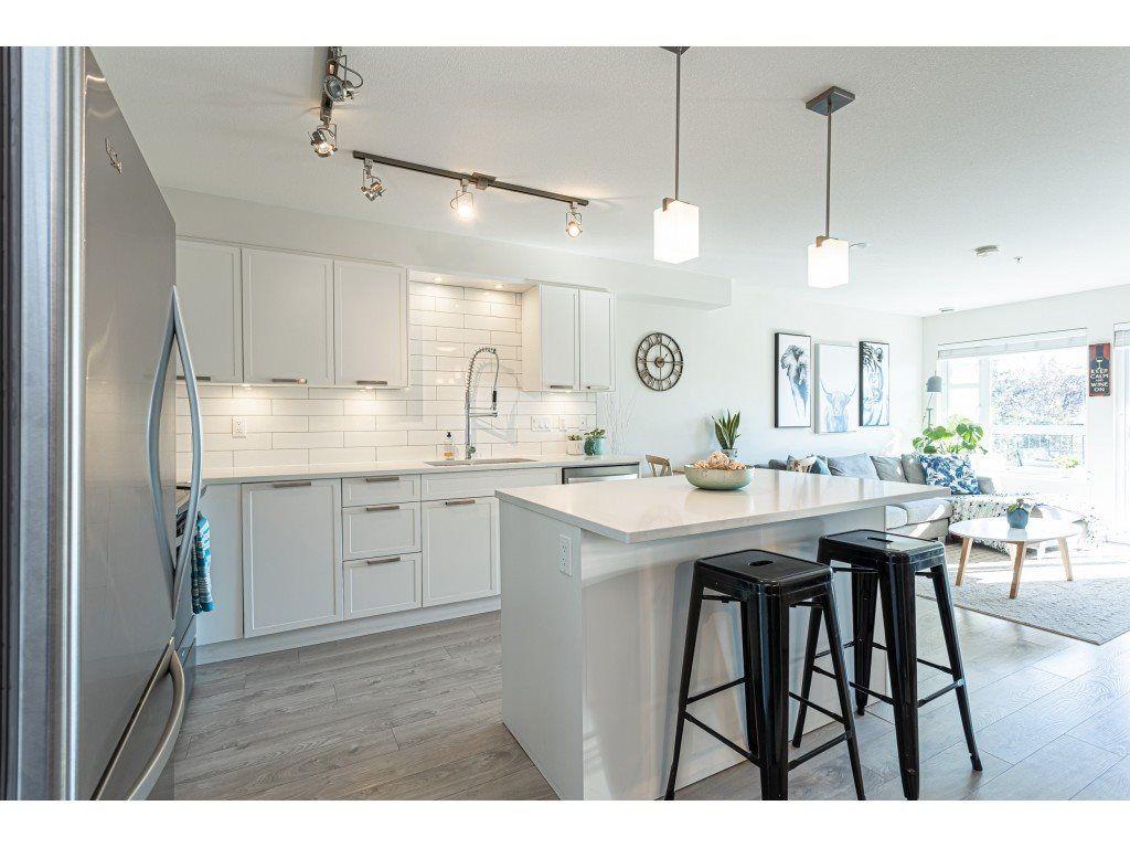 """Main Photo: 208 22562 121 Avenue in Maple Ridge: East Central Condo for sale in """"EDGE ON EDGE 2"""" : MLS®# R2512661"""