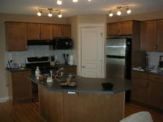 Photo 2: 1212 - 84 Street  SW: House for sale (Summerside)