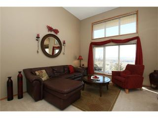 Photo 10: 35 GLENEAGLES View: Cochrane House for sale : MLS®# C4106773