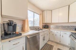 Photo 4: 104 5340 17 Avenue SW in Calgary: Westgate Row/Townhouse for sale : MLS®# A1133446