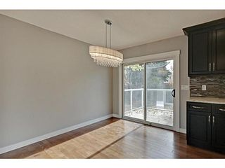 Photo 9: 27 Meadowview Road SW in Calgary: Meadowlark Park Detached for sale : MLS®# A1084197