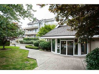 """Photo 1: 201 5556 201A Street in Langley: Langley City Condo for sale in """"Michaud Gardens"""" : MLS®# F1421361"""