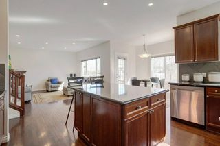 Photo 5: 102 Crestbrook Hill SW in Calgary: Crestmont Detached for sale : MLS®# A1100140