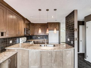 Photo 5: 327 River Rock Circle SE in Calgary: Riverbend Detached for sale : MLS®# A1089764