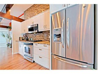 Photo 10: 6615 LETHBRIDGE Crescent SW in Calgary: Lakeview House for sale : MLS®# C4050221