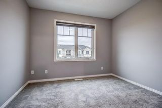 Photo 36: 129 Windstone Park SW: Airdrie Row/Townhouse for sale : MLS®# A1137155