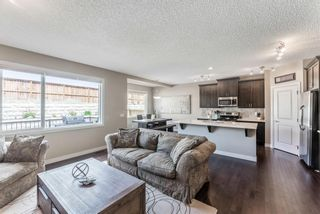 Photo 8: 205 Heritage Boulevard: Cochrane Detached for sale : MLS®# A1122442