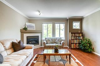 Photo 2: 12 6533 121 Street in Surrey: West Newton Townhouse for sale : MLS®# R2582556