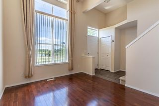 Photo 7: 119 Toscana Gardens NW in Calgary: Tuscany Row/Townhouse for sale : MLS®# A1121039