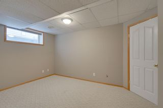 Photo 15: 106 Arbour Butte Road NW in Calgary: Arbour Lake Detached for sale : MLS®# A1075299
