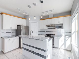 Photo 9: 526 GARRISON Square SW in Calgary: Garrison Woods Row/Townhouse for sale : MLS®# C4292186