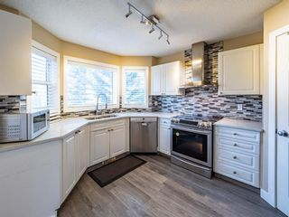 Photo 9: 27 Sandarac Road NW in Calgary: Sandstone Valley Row/Townhouse for sale : MLS®# A1148451